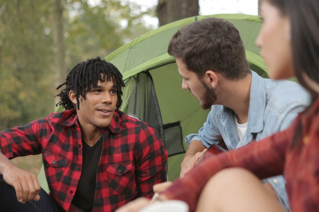 young people talking at campsite
